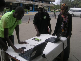 Camara Volunteers setting up the outside table to attract attention