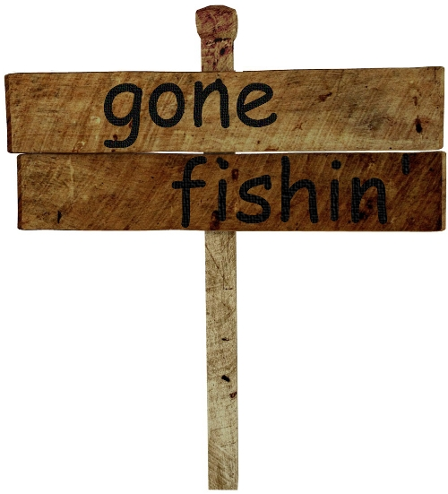 wood sign with words gone fishin